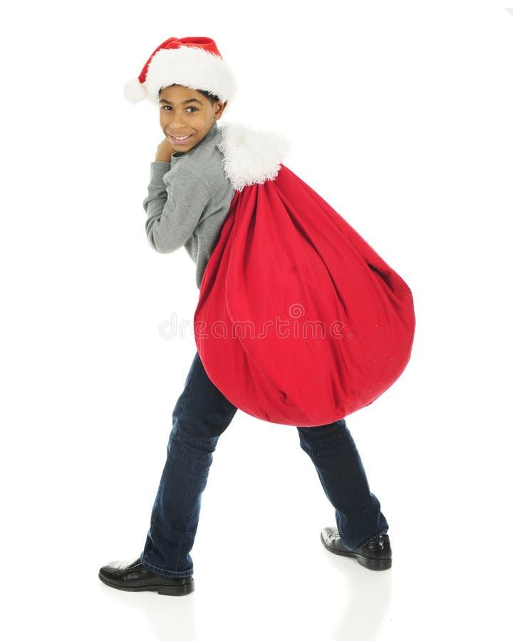 Papá Noel de ayuda con su saco imágenes de archivo libres de regalías