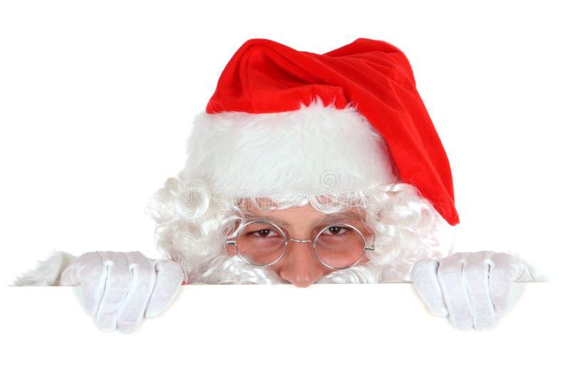 Papá Noel de ocultación foto de archivo libre de regalías