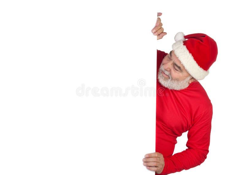 Papá Noel divertido con el cartel foto de archivo libre de regalías