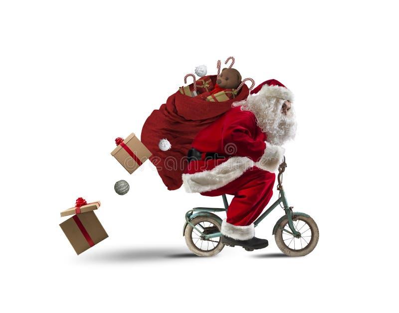 Papá Noel en la bicicleta imagen de archivo