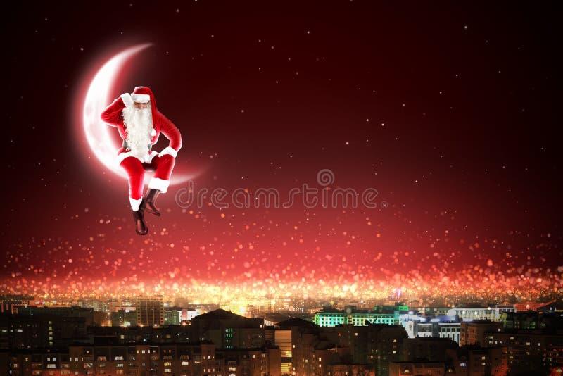 Santa en la luna imagen de archivo libre de regalías