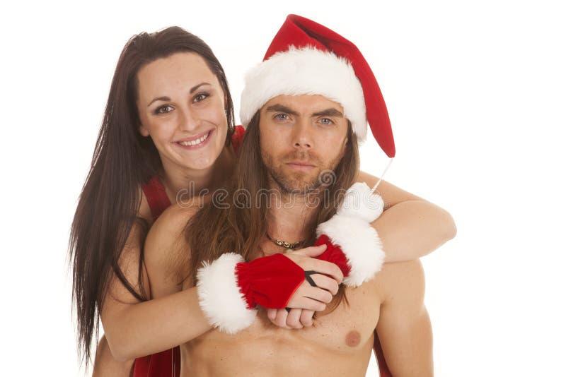 Papá Noel la junta detrás de los brazos alrededor fotos de archivo
