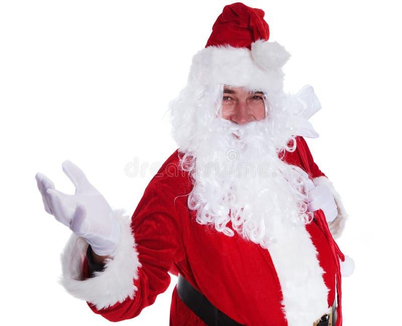 Papá Noel le está acogiendo con satisfacción imagen de archivo