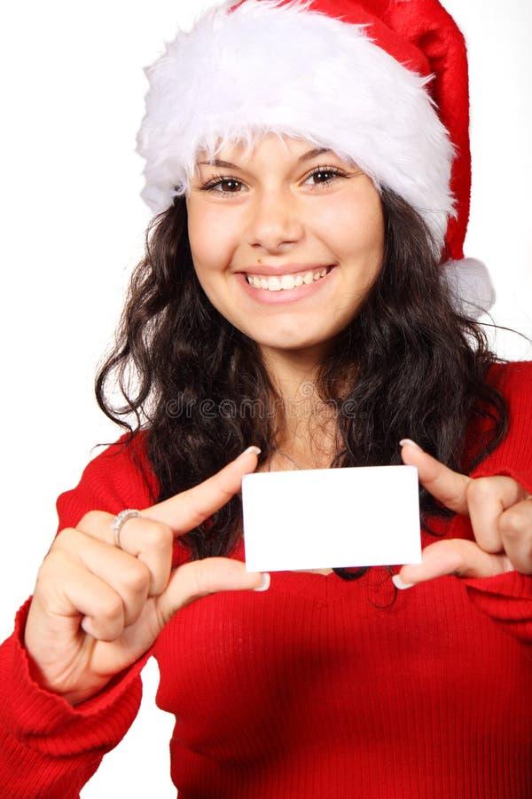 Papá Noel lindo que sostiene la tarjeta en blanco foto de archivo libre de regalías