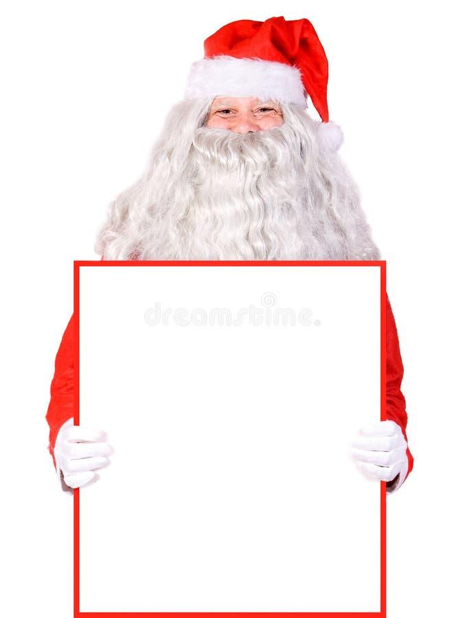 Papá Noel que lleva a cabo una muestra en blanco fotos de archivo