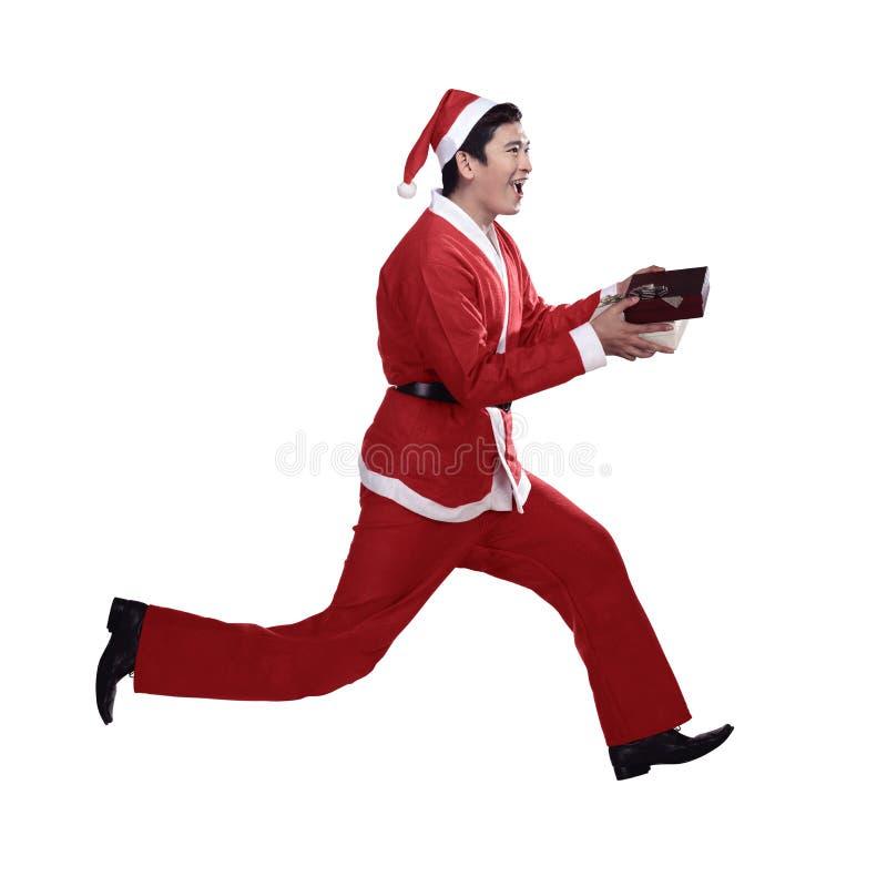 Papá Noel que se ejecuta fotos de archivo