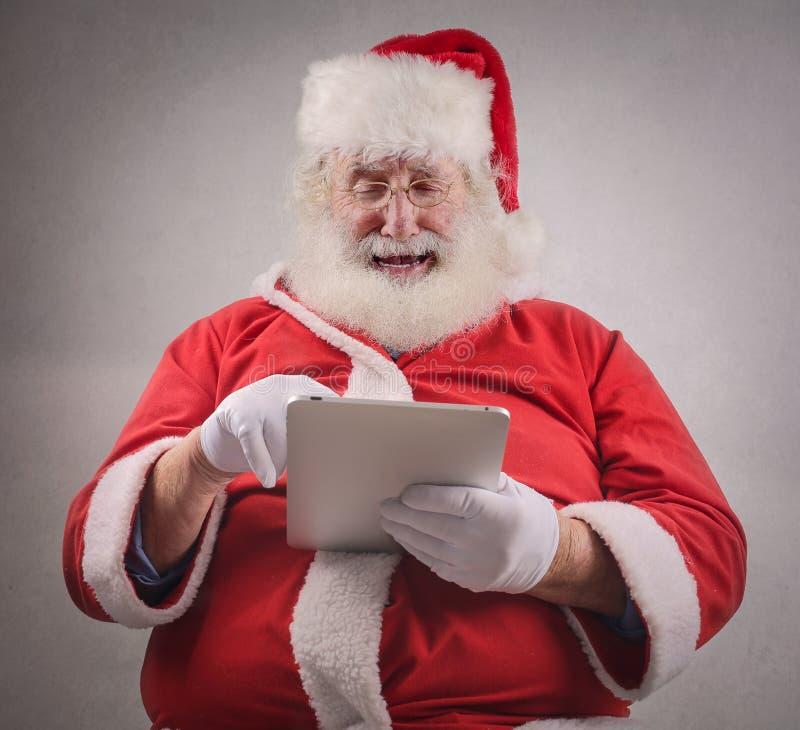 Papá Noel tecnológico fotografía de archivo