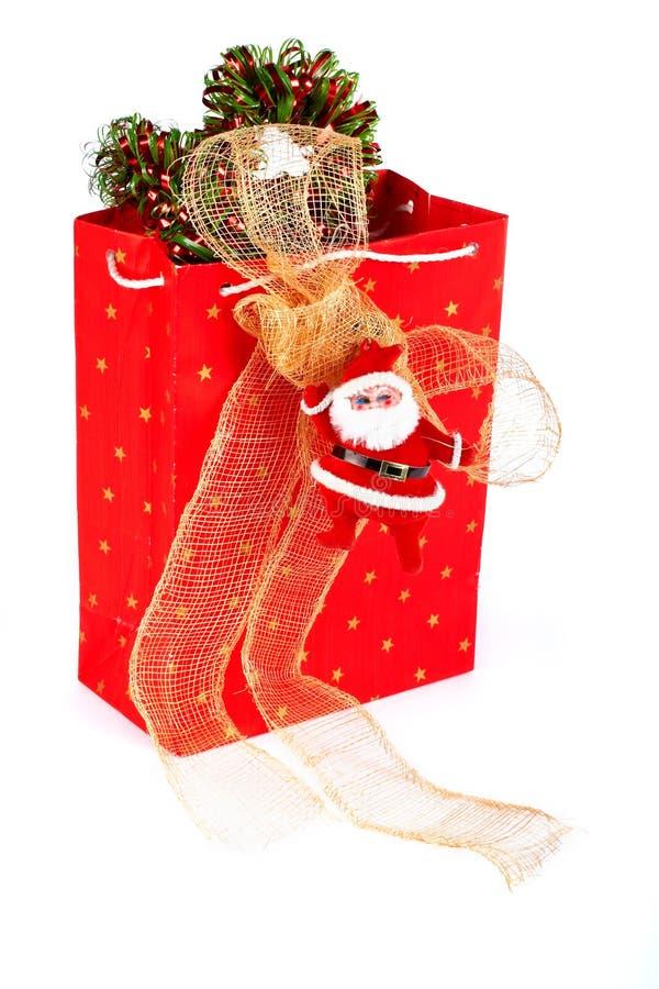 Papá Noel y bolso rojo imagenes de archivo