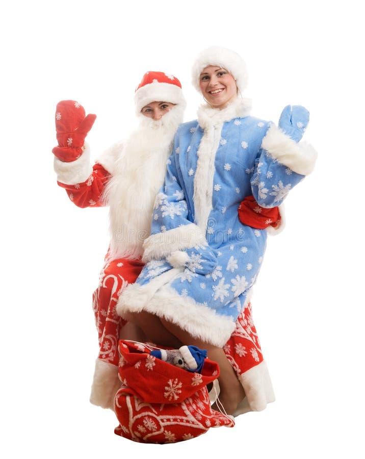 Papá Noel y doncella de la nieve imágenes de archivo libres de regalías