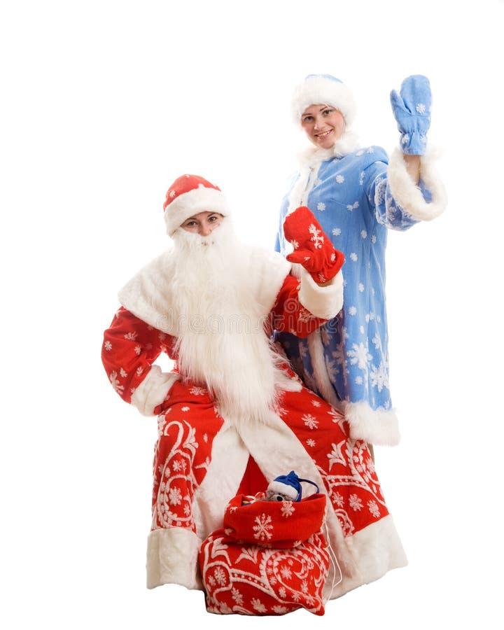 Papá Noel y doncella de la nieve imagen de archivo libre de regalías