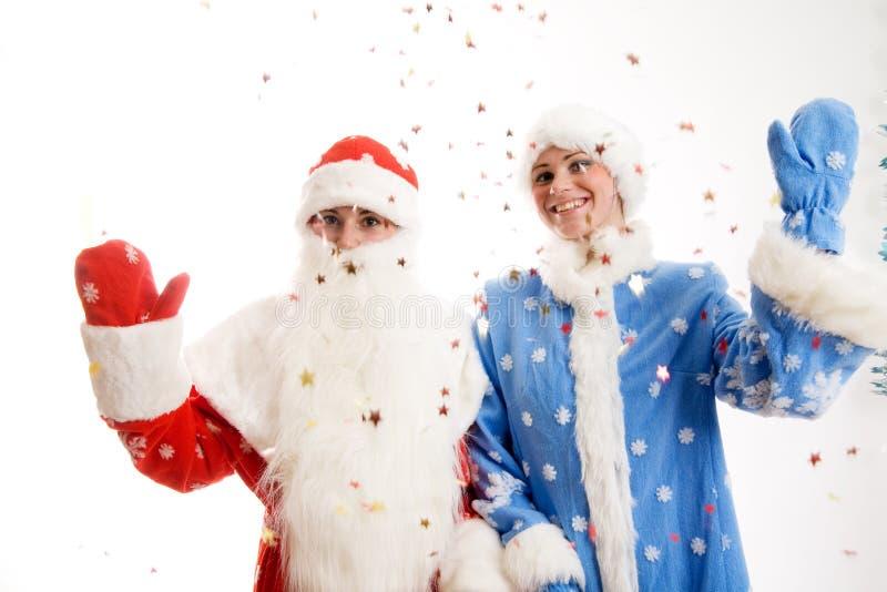 Papá Noel y doncella de la nieve fotografía de archivo libre de regalías