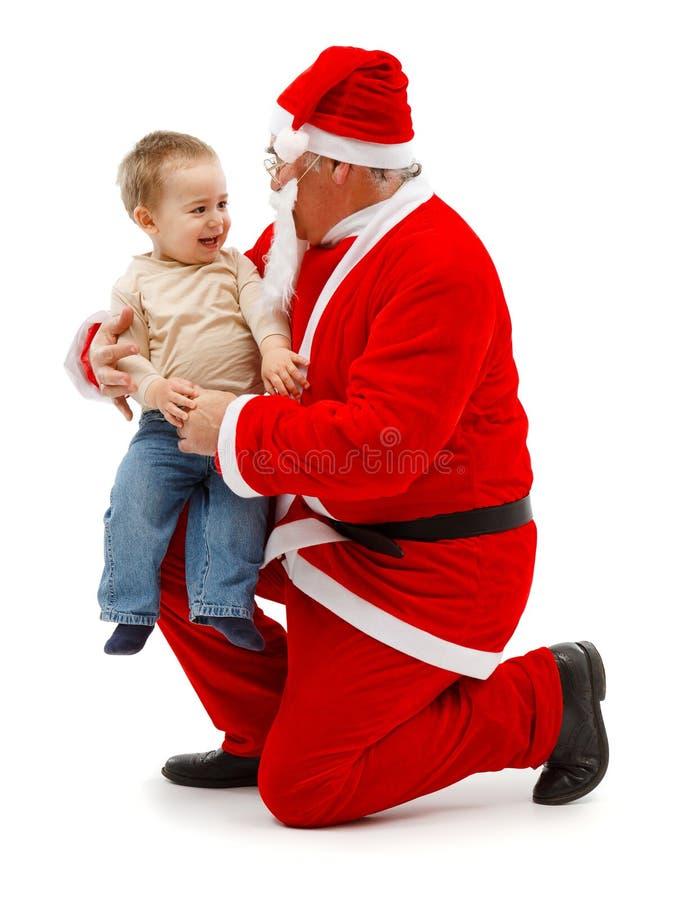 Papá Noel y niño pequeño fotos de archivo libres de regalías