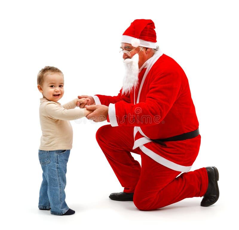 Papá Noel y niño pequeño junto fotografía de archivo libre de regalías