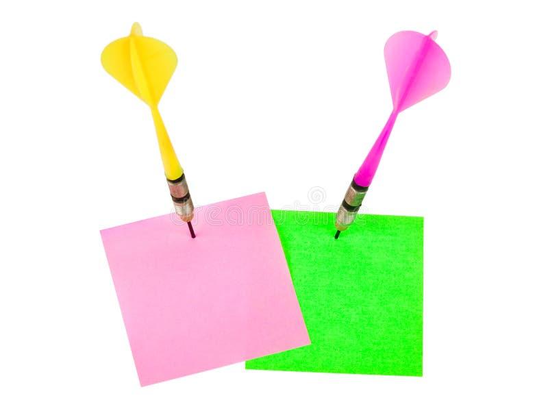 Papéis de nota e setas dos dardos imagens de stock