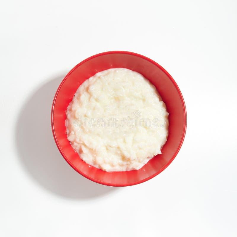 Papa de aveia, mingau ou pudim liso do arroz com leite fotografia de stock royalty free