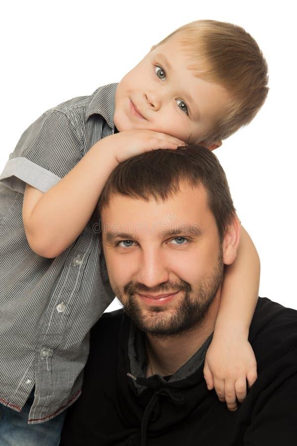 Papa die zoon koesteren royalty-vrije stock foto