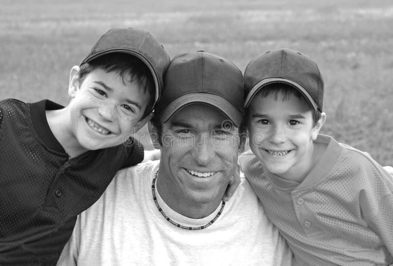Papa en Jongens stock afbeelding