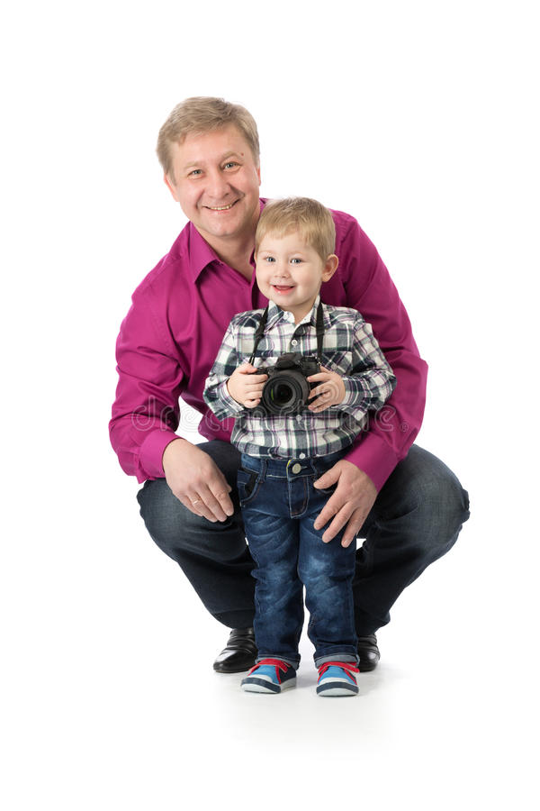 Papa met zijn zoon en een camera royalty-vrije stock foto