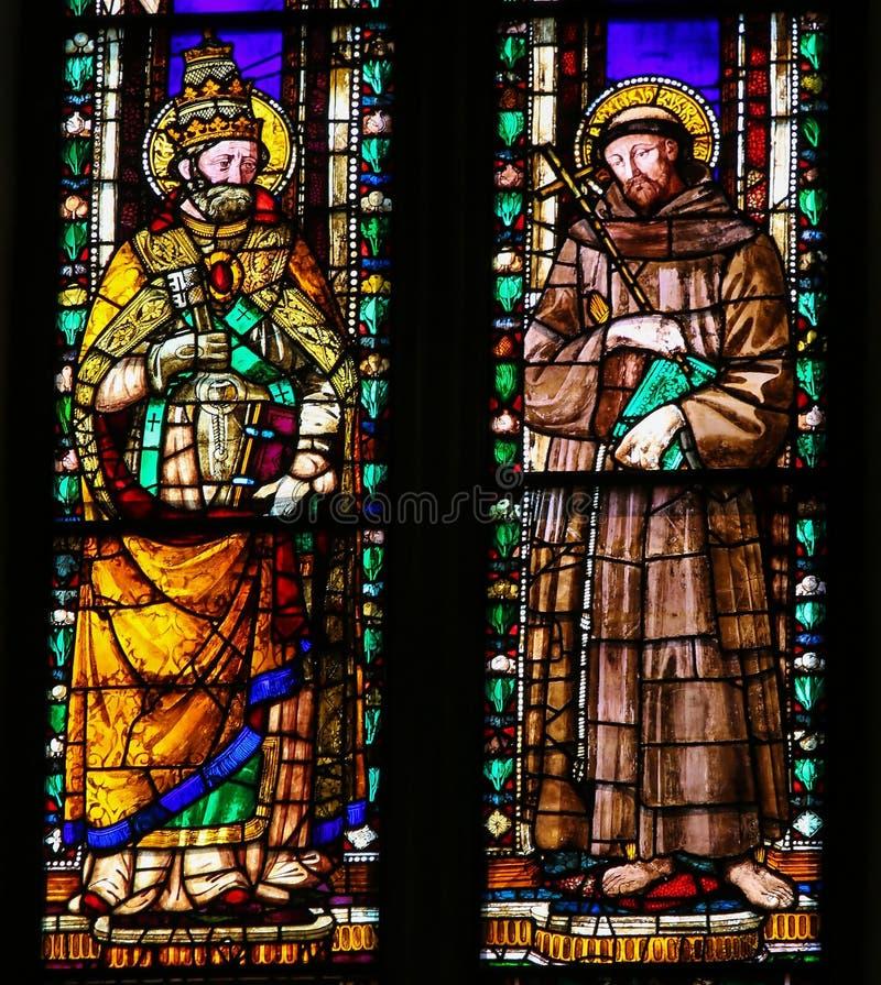 Papa St Gregory o grande e o St Francis - vitral fotos de stock