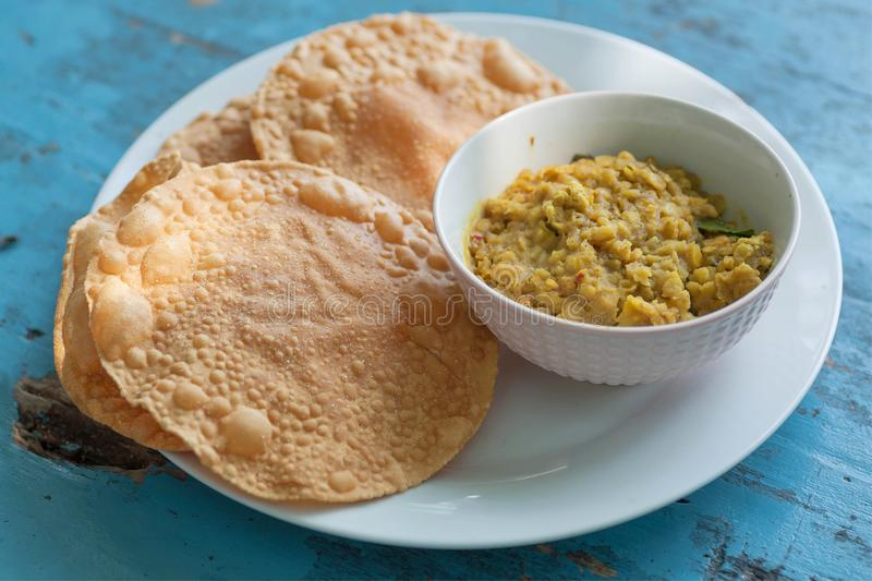 Papadum bread and vegetarian dal from lentils or beans. Food popular in Sri Lankan, Indian and Bangladeshi cuisines royalty free stock photos