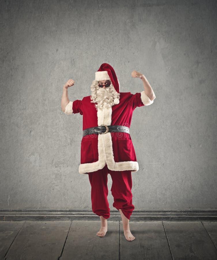 Papai Noel com óculos de sol imagens de stock royalty free
