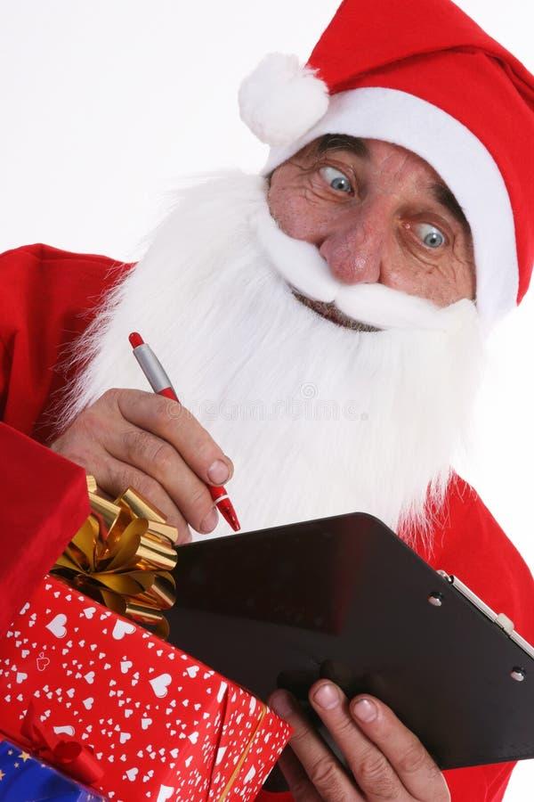 Papai Noel com lista imagens de stock royalty free