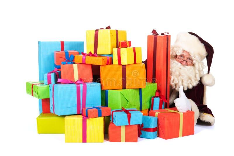 Papai Noel com muitos apresenta fotografia de stock royalty free