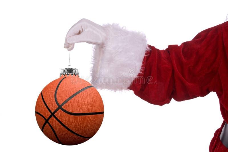 Papai Noel com ornamento do basquetebol imagens de stock