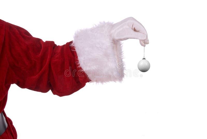 Papai Noel com ornamento do golfe fotografia de stock royalty free