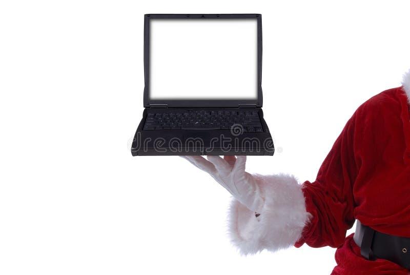Papai Noel com portátil foto de stock royalty free