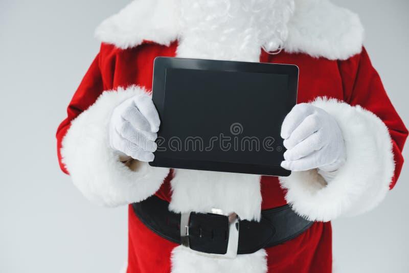 Papai Noel com tabuleta digital imagem de stock