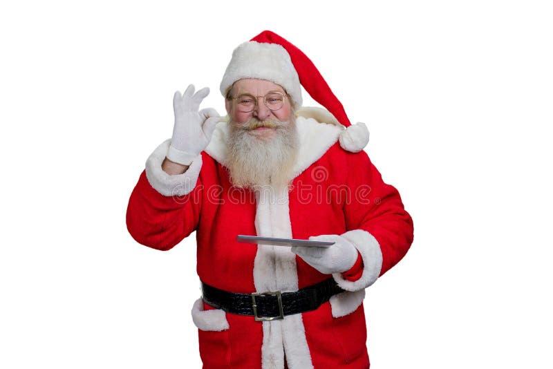 Papai Noel com tabuleta digital foto de stock