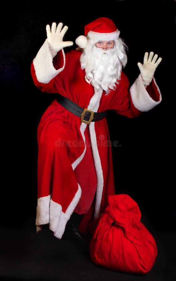 Papai Noel com um saco fotos de stock royalty free