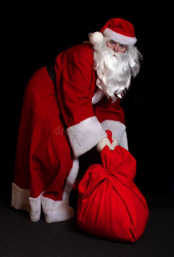 Papai Noel com um saco imagens de stock royalty free