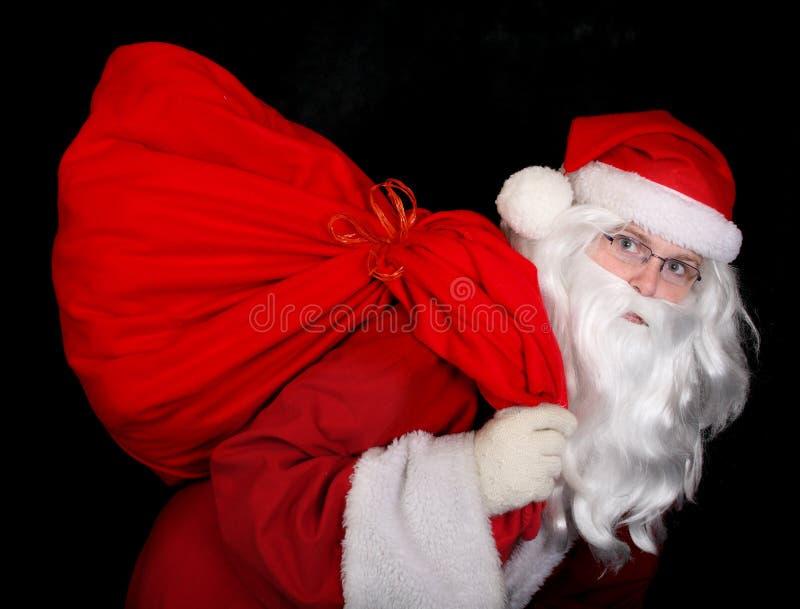 Papai Noel com um saco imagem de stock royalty free