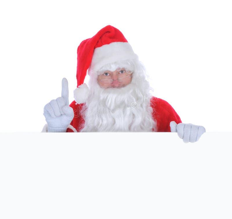 Papai Noel com um sinal em branco foto de stock