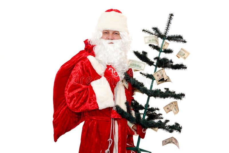 Papai Noel e a árvore do dinheiro fotografia de stock