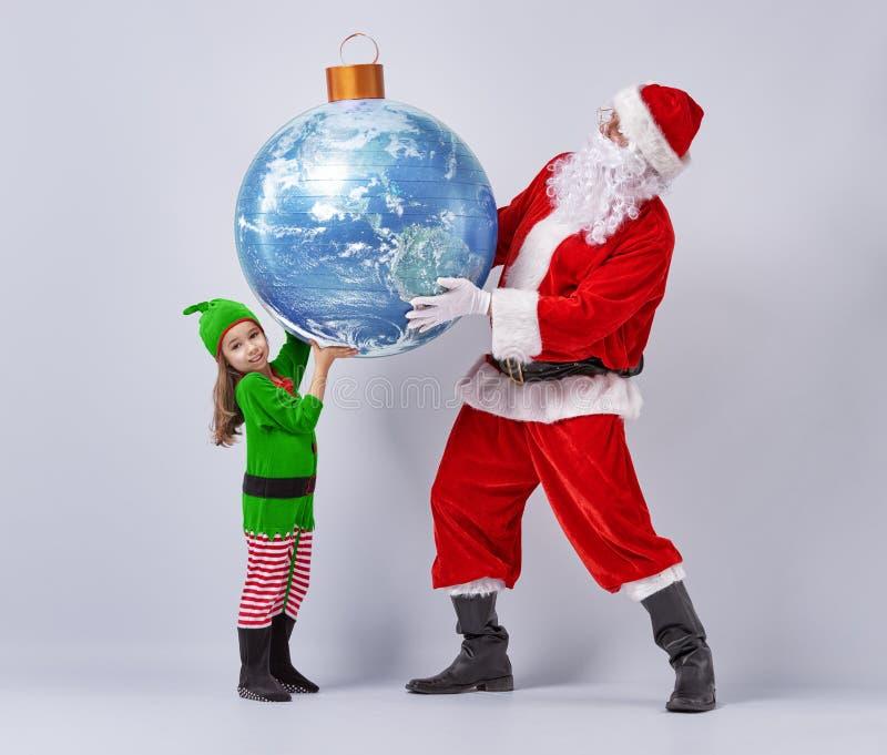 Papai Noel e menina fotografia de stock royalty free