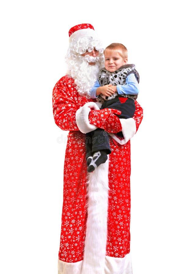 Papai Noel e miúdo imagem de stock