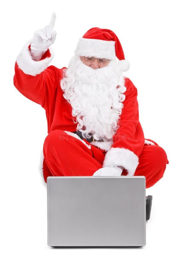 Papai Noel e portátil surpreendidos no branco foto de stock