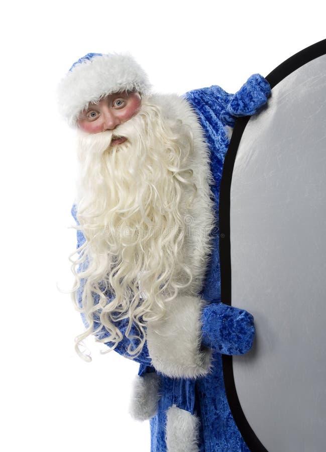Papai Noel está olhando foto de stock