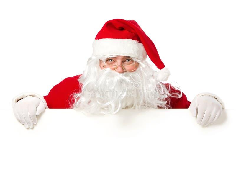 Papai Noel feliz atrás do sinal em branco fotografia de stock royalty free