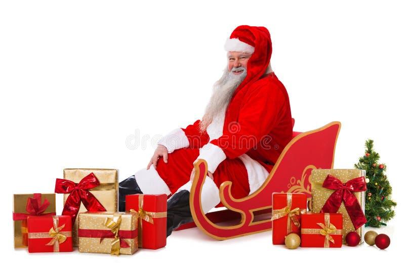 Papai Noel feliz com pequeno trenó fotos de stock