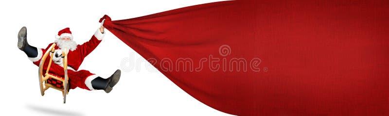 Papai Noel louco em seu saco vermelho grande do presente do trenó fotos de stock