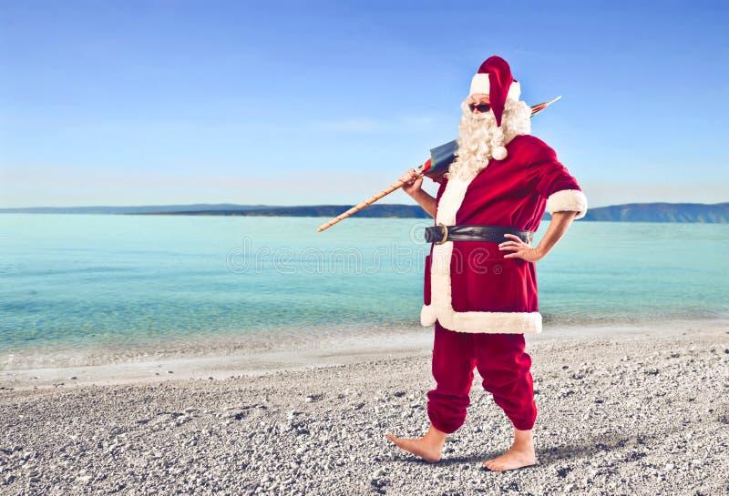 Papai Noel na praia fotos de stock