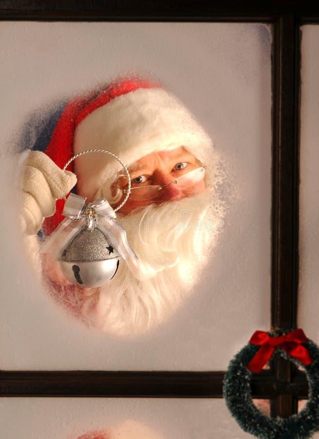 Papai Noel no indicador com Bell de prata imagem de stock