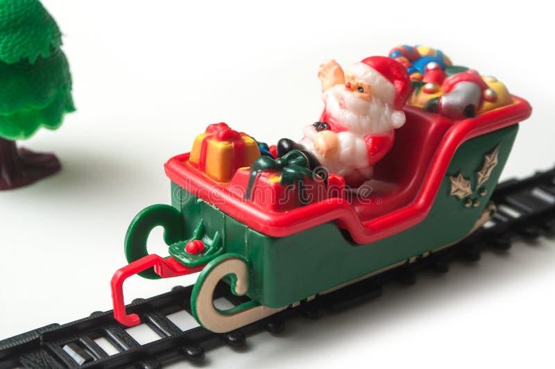 Papai Noel no trem diminuto do brinquedo no backgroun branco imagem de stock royalty free