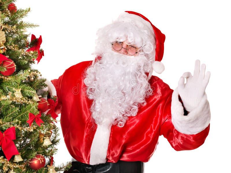 Papai Noel pela árvore de Natal. imagens de stock