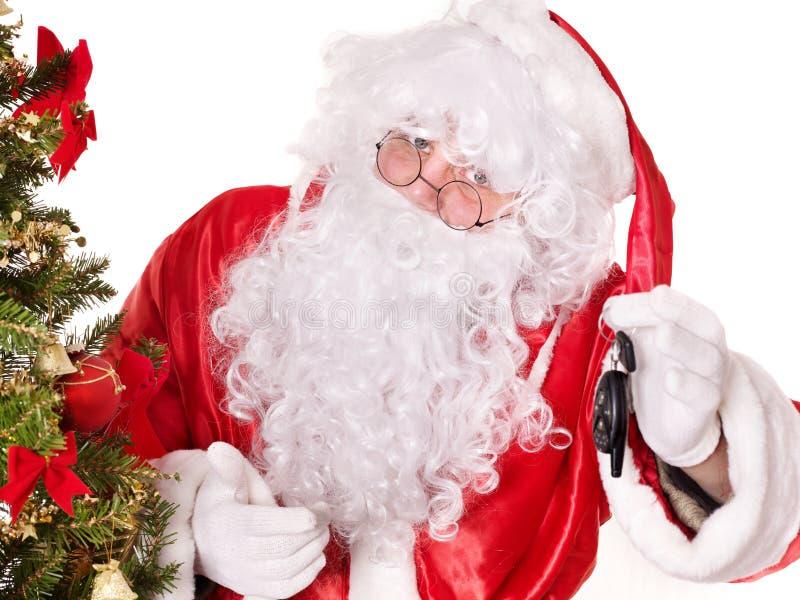 Papai Noel que dá auto chaves. imagens de stock