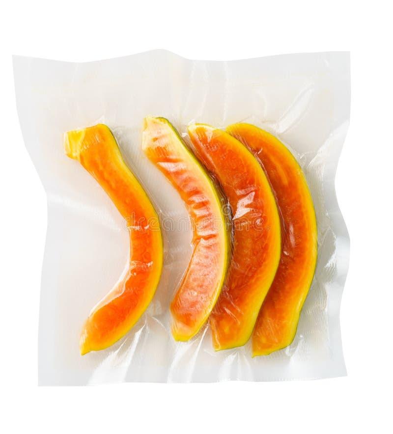 Papaia chiusa sotto vuoto immagine stock